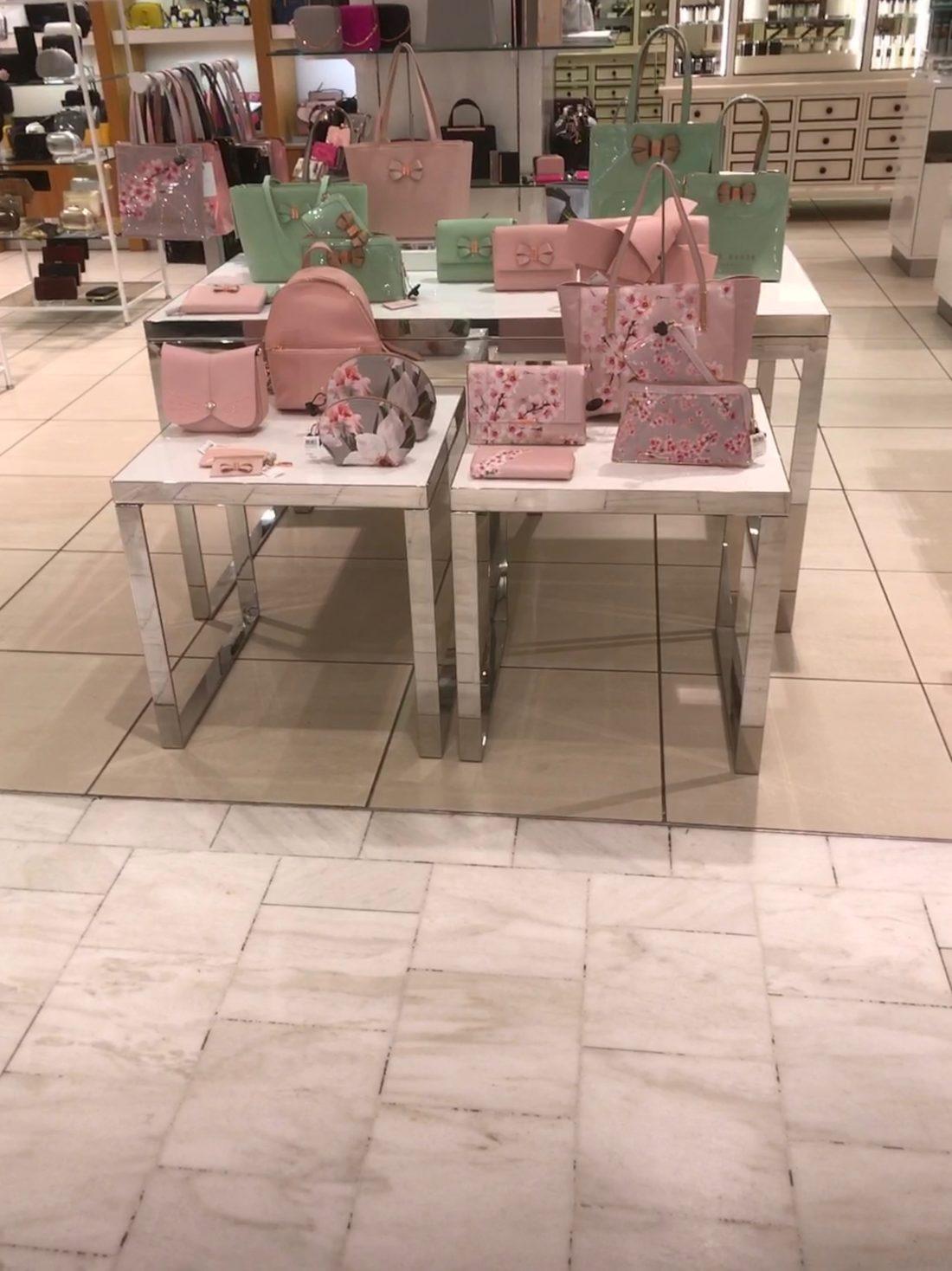 "Fenwick Ltd Brent, London (""Hand Bag Department"") bespoke feature hazel tables"